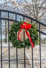 Gate to a horse farm with a Christmas holiday wreath