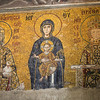 Emperor John II Komnenos and Empress Irene present gifts to the Virgin Mary and the Christ child. Mosaic in the Hagia Sophia, Istanbul, Turkey.
