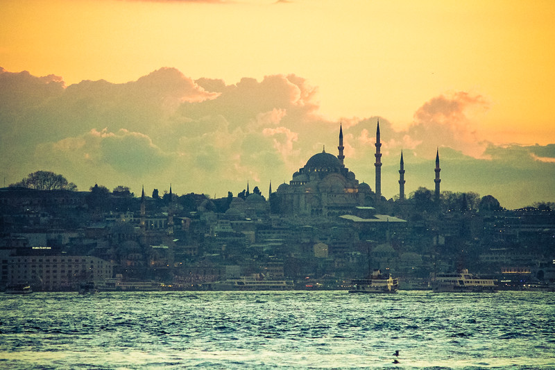 The sun sets over Eminonu, a very busy port in Istanbul, Turkey.