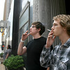 Tyler and Jake Grigffith smoke in front of First National in downtown Oklahoma City Tuesday. PHOTO BY MAIKE SABOLICH