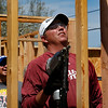 Professional (PGA) golfer Bo Van Pelt works the nail gun to build the framing of a habitat for humanities home in West Tulsa.