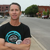 Phil Kaiser, co-founder of the music festival pauses for a photograph in Tulsa's Brady Arts District where the Center of the Universe Festival will be held. The headliners of the festival perform on a stage outside of Cain's Ballroom on Main Street, but the bars, restaurants and venues throughout the Brady District will play host to acts with a range of music all weekend.