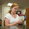 Teller Arial Jones counts out her drawer at First State Bank in Noble, OK.
