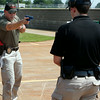 Tulsa Police range master, sergeant Brian Hill, provides instruction to his students.