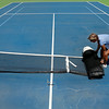 Melissa McCorkle, Director of Tulsa County Tennis Operations, rolls up a net in preparation for the ceremonial groundbreaking for the new Case Tennis Center at LaFortune Park in Tulsa.