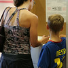 In south Tulsa a voter receives some help from her son as she fills in her ballot..<br /> <br /> ***Subject requested we not use her or her sons name***