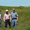 Bob Hamilton, director of the Tallgrass Prairie Preserve discusses with John Hurd, Osage County Cattlemen's Association's chairmain and Kerry Sublette, Sarkeys Professor of Environmental Engineering at the University of Tulsa, damage done by several oil and salt water spills on a lease within the Tall Grass Prairie.