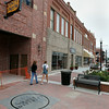 Pedestrians stroll down the streett in the Rose District in downtown Broken Arrow.