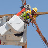 OG&E performs maintanance to power lines at NW 12th and Harvey in Oklahoma City, OK.
