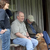 Denise Deason-Toyne,  Ed Fite and Ed Brocksmith sit at a cabin and chat at the Illinois River near Tahlequah