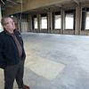 Terry Argue inspects Tulsa's Mid-continent building 15th floor remodeling project.