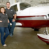 Cristi and Casey Trammell, partners of Tulsa Aviation Group, stand by one of their planes at Atlantic Aviation at Tulsa International Airport.