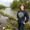 Denise Deason-Toyne, pauses for a photo on a bank of the Illinois River near Tahlequah