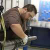 A workman at D&L Tools assembles a downhole tool at the companies west Tulsa location.