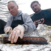 Bob Parker and friend Scott Newfield check on the barbecued pork ribs that just came out of the smoker.