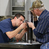 Stephen Snyder and Chuck Peavler repair an oilfield tool at the Kline Tools warehouse in Tulsa.