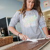 Megan Morris cuts brownies at Cupcake Heavan located at 12317 N Rockwell in Oklahoma CIty, OK.