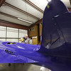 At his Tulsa hanger Scotty Wilson works on the finishing touches of the replica Bugatti 100P aircraft he built.