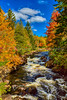 The Croches waterfalls and fall foliage color in Mont-Trembalnt National Park, Quebec, Canada.