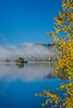 Morning fog lifting from small islands in the Saint-Maurice River in Shawinigan, Quebec, Canada.