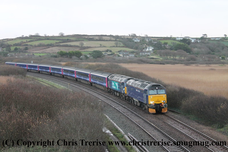 """Class 57 Diesel Locomotive number 57 603 named """"Tintagel Castle"""" passes Marazion with 1C99 2345 London Paddington to Penzance """"Night Riviera"""" sleeper service.  Class 57 Diesel Locomotive number 57 310 named """"Pride of Cumbria"""" is also in the consist.<br /> 20th December 2014"""