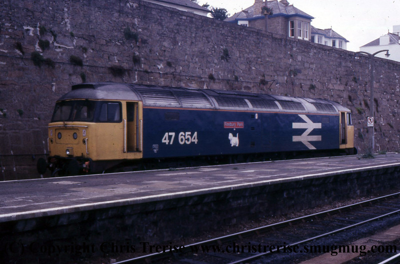 "Class 47 Diesel Locomotive number 47 654 named ""Finsbury Park"" is seen at Penzance.<br /> September 1987"