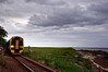 First Scotrail's 158726 with the 2H64 16:00 Wick to Inverness service just north of Brora under a darkening sky.