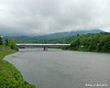 05.24.2013  The Cornish-Windsor Covered Bridge spans the Connecticut River in front of a cloud covere Mt. Ascutney