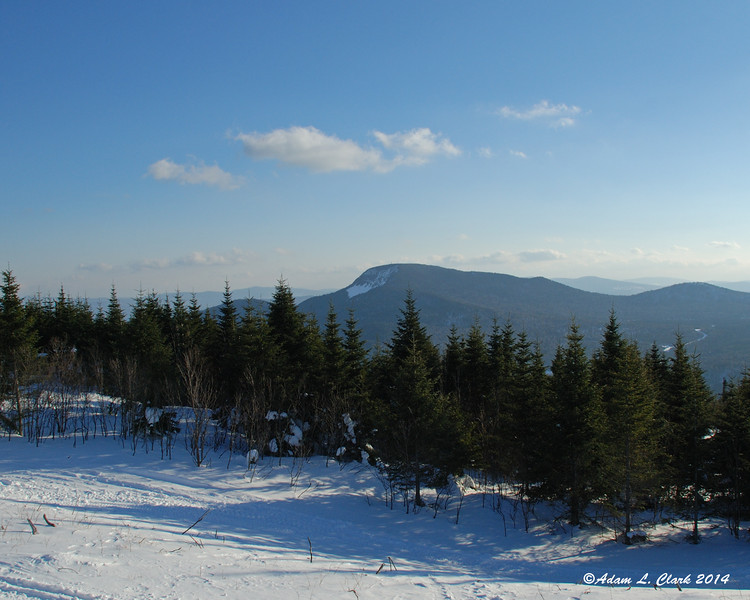 03.08.2014  While out snowmobiling today it went from cloudy to clear skies turning into a great day for some riding.  Here, Mt. Magalloway can be seen late in the day from Diamond Ridge