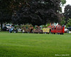 07.25.2014 <br><br>At a weekly local flea market, someone has made this train to pull kids around in.  It includes and old carriage (with horses) from the western days, Mater from the Cars movies, a Sponge Bob cart, and a fire truck complete with bells to ring