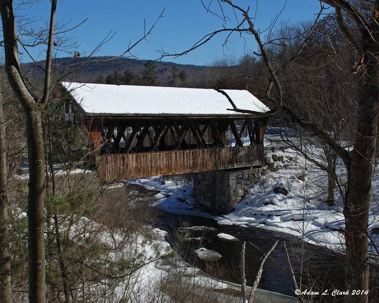 03.05.2014  After walking through some snow and in the trees, I finally found a view of the Packard Hill Covered Bridge that shows this side well