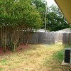Backyard w/gate leading to large separate yard