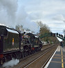 Stanier Black Fives 44871 & 45407 slow to a halt at Godstone to pick up passengers  for The Cathedrals Express  to Minster.<br /> <br /> 23 December 2014