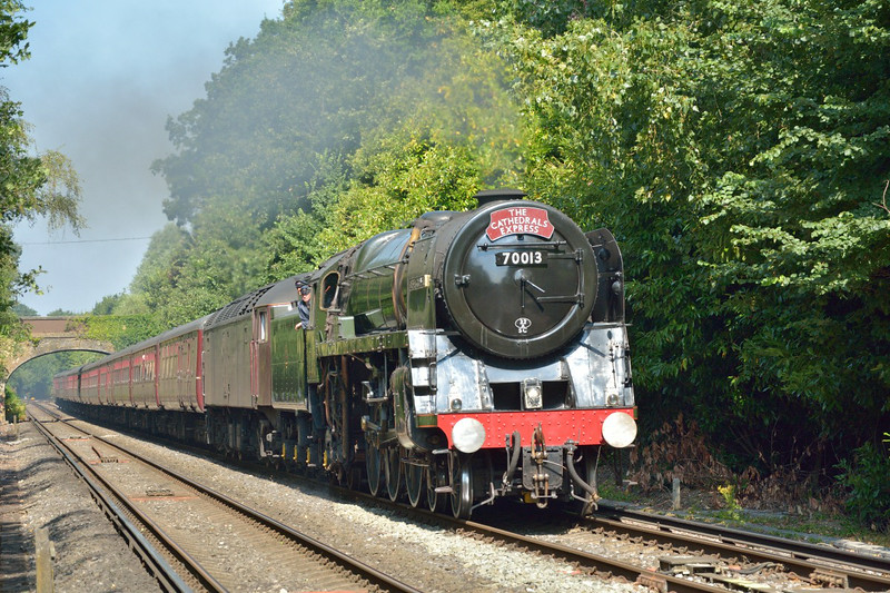 BR Britannia No. 70013 Oliver Cromwell passes Virginia Water with 1Z65 The Cathedrals Express from Victoria - Bristol Temple Meads. <br /> <br /> 24 July 2014