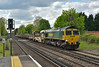66565 takes a slow trip from Woking Up Yard. to Eastleigh<br /> Already running almost an hour late it is seen here passing West Byfleet on its way to Mitre Bridge before reversing.<br /> <br /> 27 April 2015