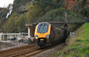 Voyager 220027 bursts out of Kennaway Tunnel into Dawlish with 1S49 the 11.25 XC service from Plymouth to Dundee  26 November 2013