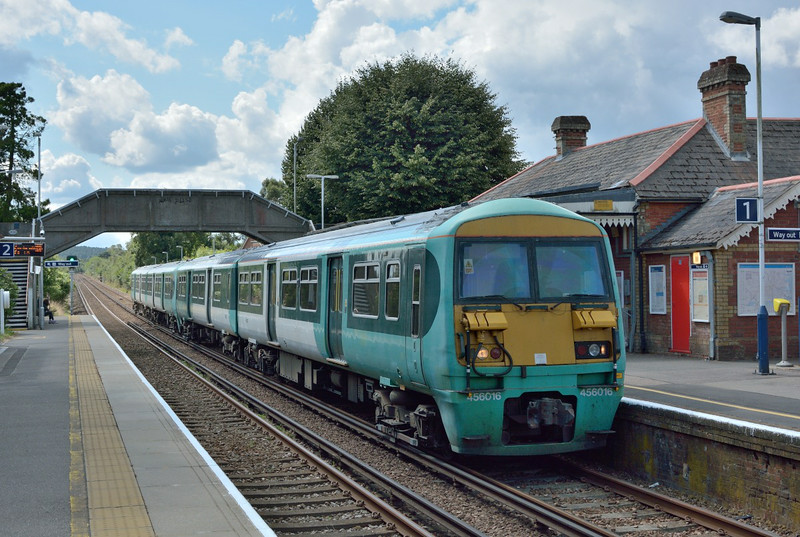 Former 'Southern' Class 456 are still working in unbranded and unrefurbished condition.<br /> 456016  and 456022 halt at Bagshot forming 2N34 the 11.30 from Guildford to Ascot<br /> <br /> 20 August 2014