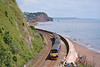 150123 scurries into Teignmouth as 2T14 the 11.24 from Exmouth to Paignton.<br /> Yet another popular location for both walkers and photographers closed while repairs are made to the cliff face after winter storms caused rock falls in the area.<br /> <br /> 15 June 2014