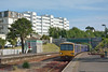 143617 arrives at Torquay with 2F49 forming the 17.13 from Paignton to Exmouth set against the contrasting architecture of The Grand Hotel and former platform signalbox.<br /> <br /> 21 June 2014