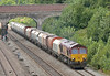 66134 passes Twyford with an interesting rake of hoppers as it heads to  to Churchyard Sidings from Whatley Quarry<br /> <br /> 28 July 2014