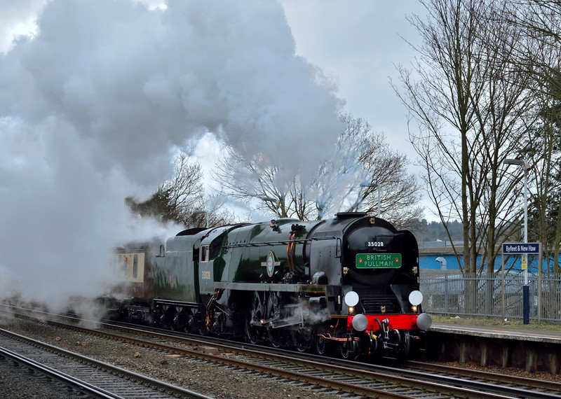 35028 'Clan Line' climbs away from Addlestone Junction through Byfleet & New Haw  working 1Y82 Belmond British Pullman luncheon train from Victoria<br /> <br /> 28 February 2015