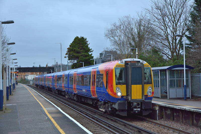 A gleaming 458531 brightens a gloomy day as it halts at Egham with 2S38 the13.03 from Weybridge to Waterloo<br /> <br /> 22 December 2014