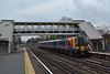 There's no getting away from Desiro's on the SWML.<br /> <br /> Slowing to a halt at West Byfleet, 450006  forms 1A36 the  11.44 service from Alton to Waterloo<br /> <br /> 20 February 2015
