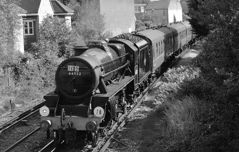 Shades of 1967!<br /> <br /> Black 5 No. 44932  leans to the curve through Egham as it heads for the coast.<br /> <br /> 30 July 2014