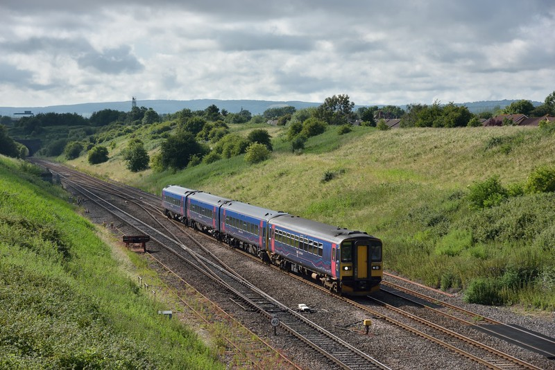 153318 leads 1F27 16.30 service from  Cardiff Central to Portsmouth Harbour out of the Severn Tunnel.<br /> <br /> 2 July 2015