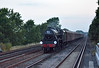 44932 races through Hersham just after sunset <br /> with the return working of  'The Dorset Coast Express'  to Waterloo.<br /> <br /> 30 July 2014