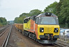 70809 rattles through West Byfleet at the head of  6Y42 Hoo - Eastleigh engineers train<br /> <br /> 1 August 2014