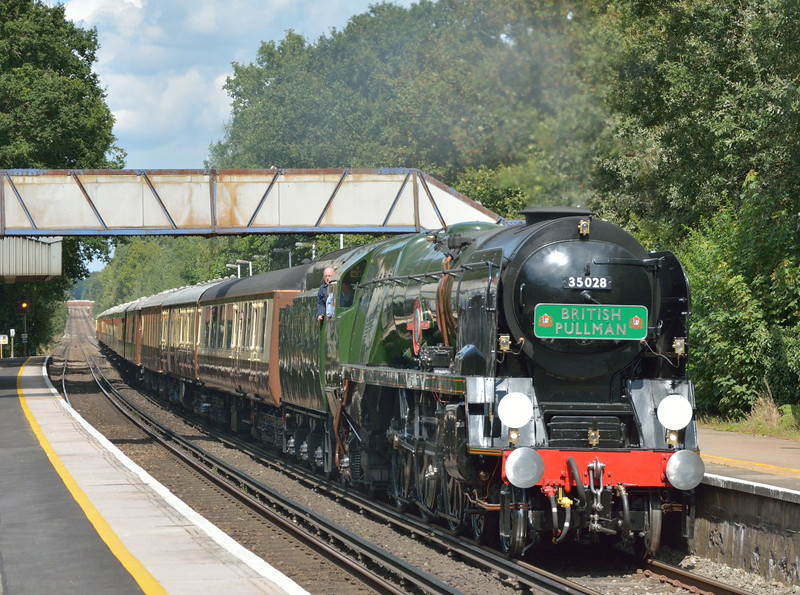 Merchant Navy 35028 'Clan Line'  storms through Worplesdon with The Belmond Pullman luncheon train around the Surrey Hills.<br /> <br /> 22 August 2014