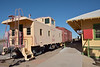 Former Union Pacific caboose No.25147 and boxcar stand next to the old Boulder City Depot at Clark County Museum, Henderson, NV