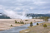 Steam vents from Grand Prismatic Spring and nearby Excelsior Geyser as the water runs off into the Firehole River.<br /> <br /> Midway Geyser Basin,Yellowstone